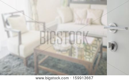 Opened White Door To Living Room Interior With Set Of Elegant Teacup
