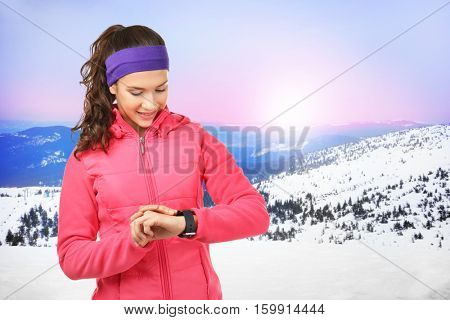 Young woman with pulsometer on run. Sport and healthy lifestyle concept.