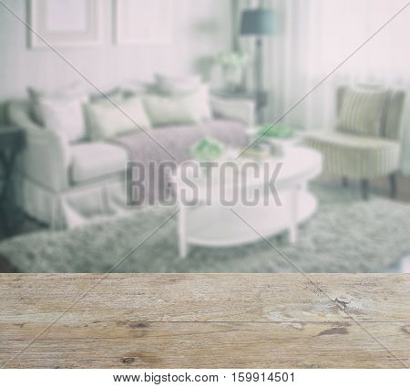 Wooden Table Top With Blur Of Living Room Interior With Set Of Elegant Teacup