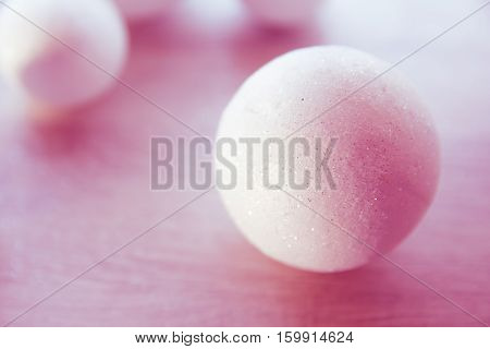 many small white balls toys new year symbol on red background top view there is a place for the text as a background and substrate