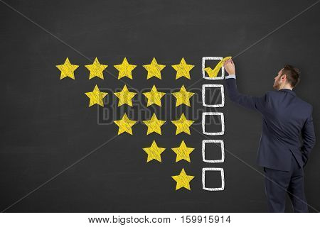 Business Person Drawing Customer Satisfaction on Blackboard