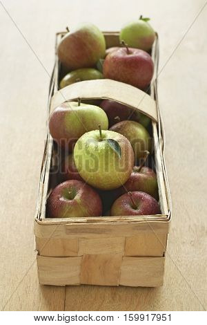 Apples in basket on table, elevated view, close-up