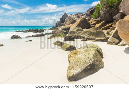 Beautifully shaped granite boulders and a perfect white sand at Anse Petite, La Digue island, Seychelles