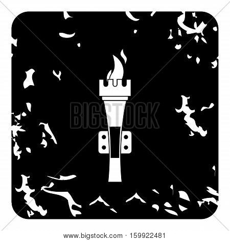 Torch icon. Grunge illustration of torch vector icon for web