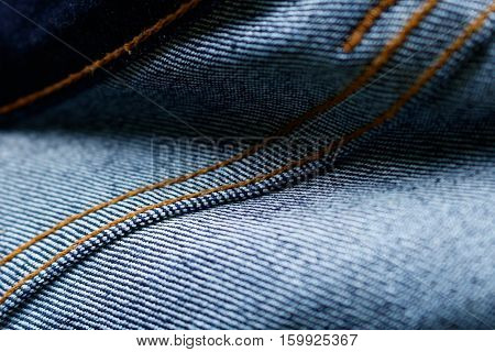 Closeup back side of Blue jeans seam background