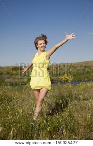 Happy Young Fresh Female Enjoying The Fresh Air On Nature