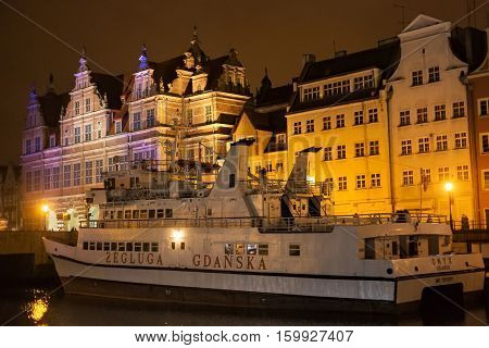 POLAND GDANSK - DECEMBER 12 2014: Passenger ship on the the Motlawa river in the background of the city's historic buildings. Gdansk is a Polish city on the Baltic coast and popular center of tourism.