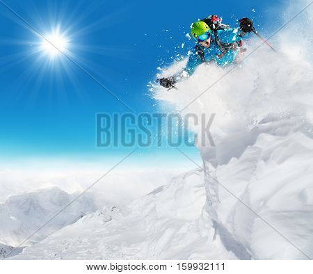 Freeride skier ready to jump in freeze motion of snow powder.