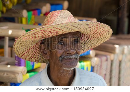 Portrait Of Old Malagasy Man With Straw Hat