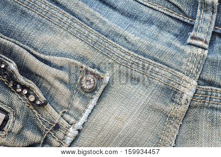 Denim jeans texture or denim jeans background with seam and pocket. Old grunge vintage denim jeans. Stitched texture denim jeans background of jeans fashion design.