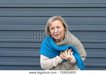 Senior Lady Clutching Her Chest In Pain