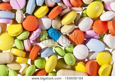 background of different kind colorful medical pills.