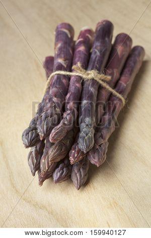 Bunch of fresh purple asparagus