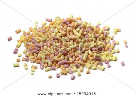 Heap pf colored sprinkles on white background