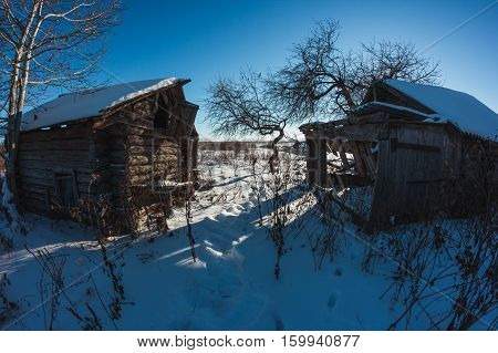 Abandoned house in the Russian village in winter. Scary place.