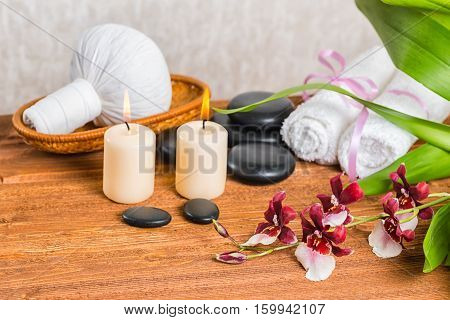 Spa Composition Of Orchid Flower, Cambria With Green Leaves, Thai Herbal Compress Ball In Basket, To