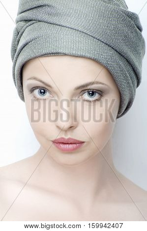 Portrait Of Beautiful Young Woman With A Turban On Her Head..