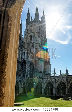 Canterbury, UK - May 1, 2011: With Special sun flare. Cloister Garden in Canterbury Cathedral in Canterbury in Kent of the UK. It is one of the most famous cathedrals in England. It is the Archbishop of Canterbury Cathedral.