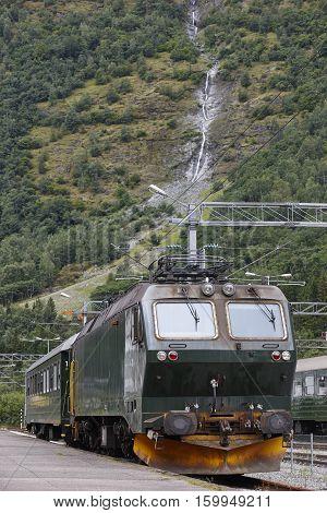 Flam railway station. Norwegian tourism highlight. Electric locomotive. Transportation. Vertical