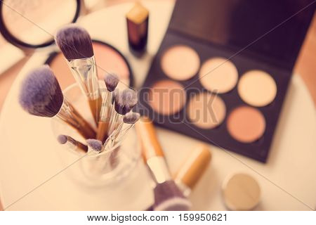 Professional makeup brushes and tools, make-up products kit, vintage filtered