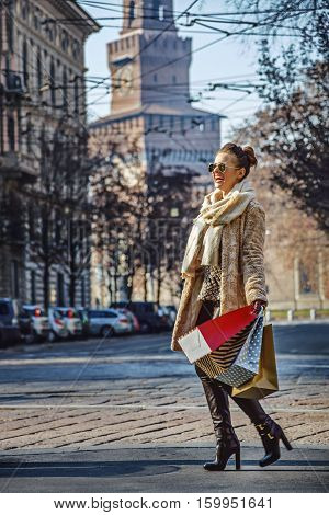 Tourist Woman Near Sforza Castle In Milan, Italy Walking