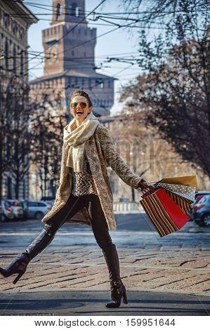 Smiling Elegant Woman In Fur Coat In Milan, Italy Walking