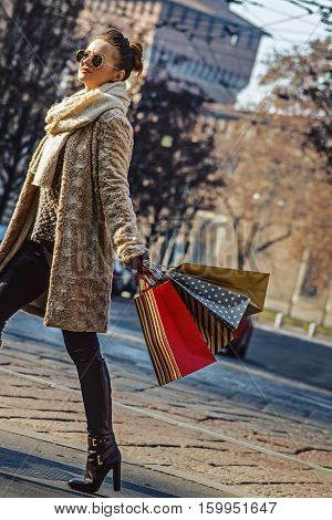 Young Woman With Shopping Bags In Milan, Italy Walking