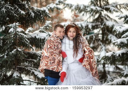 Winter wedding. Young happy bride and groom together. Marriage concept