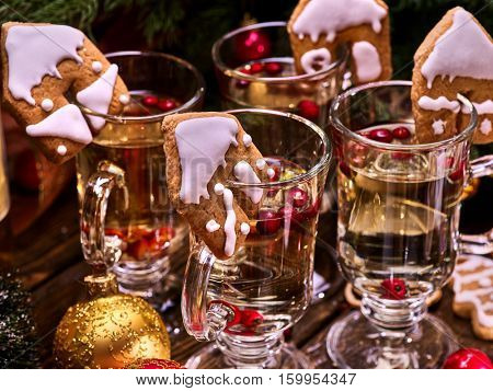 Christmas cookie punch on glasses. Christmas decorations. Large view of the photo