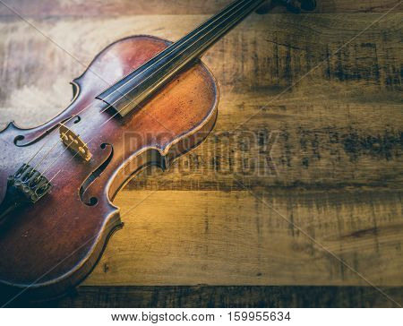 Old violin on a wooden background stringed musical instrument