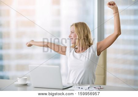 Young attractive woman at modern office desk, with laptop, stretching, getting a little exercise during the day, office workout, completing difficult task, time for lunch. Business concept illustration