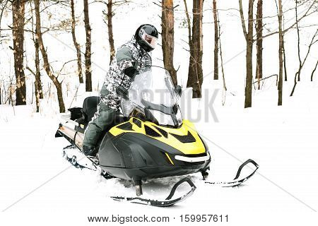 Man on snowmobile. Recreation concept on nature in winter holidays. Winter sports.