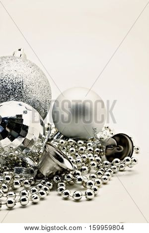 Silver Christmas Decoration, Balls, Beads, Bell Close Up Isolated