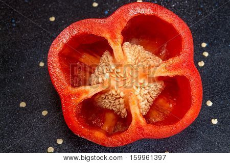 Cut Red Fresh Ripe Paprika With Inside Surface And Seeds.