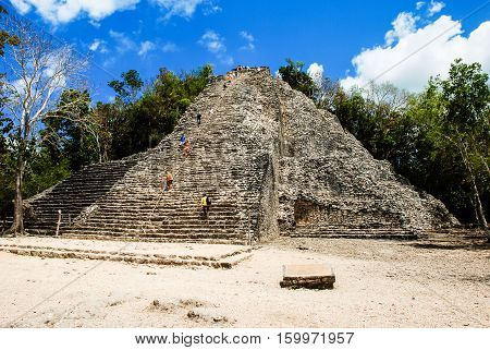 Coba Mexico. Ancient mayan city in Mexico. Coba is an archaeological area and a famous landmark of Yucatan Peninsula. Cloudy sky over a pyramid in Mexico