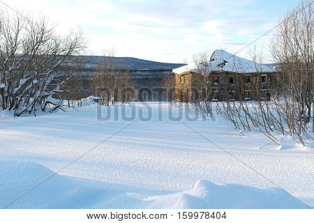 The winter. The ruined house. The snowcapped mountains and trees.The cool temperature. The sky and light clouds. The beautiful landscape. The low sun reveals the texture of the snow. Sunshine, sunbeams.