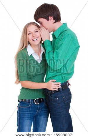 happy laughing girl listening her boyfriend. isolated on white