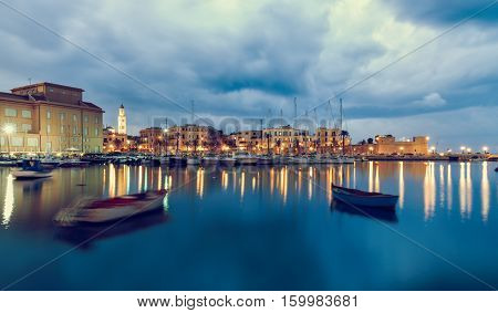 Bari seafront city view from marina. Blue sea and cloudy sky. Long exposure Filtered image