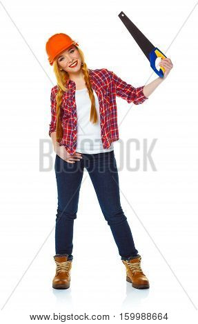 Young funny woman in helmet with a saw on a white background