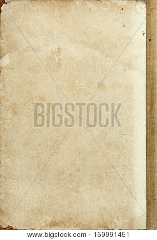 Cardboard old book cover texture with torn edge and stains