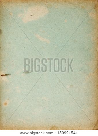 Faded copybook cover page with stains and dark borders