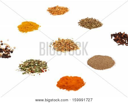 Spices set on white. Individual seasonings and mixes thereof. Low aperture shot selective focus