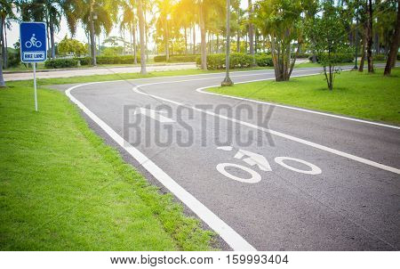 Bicycle symbol on street bike lane in the park.