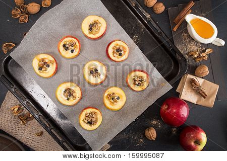 Preparing Baked Apples Stuffed With Honey And Walnuts On Baking Tray