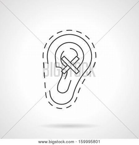 Symbol of human ear with crossed sign. Hearing impairment as a consequence of harmful effects of smoking, loud noises, illness. Flat black line vector icon.