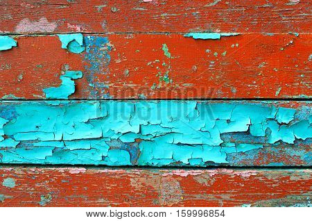 Texture background - old painted wooden texture surface with peeling blue and brown paint. Colorful texture wooden background