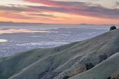 Silicon Valley and Rolling Hills at Sunset. Monument Peak, Ed R. Levin County Park, Milpitas, California, USA. poster