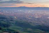 Silicon Valley and Green Hills at Dusk. Monument Peak, Ed R. Levin County Park, Milpitas, California, USA. South-West views of San Francisco South Bay and Santa Cruz Mountains with Green Hills of Santa Clara Valley. poster