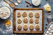 Cinnamon rolls or cinnabon handmade raw dough preparation sweet traditional dessert buns pastry food baked homemade swirl Danish mini snack. Food ingridients flat lay on kitchen table. Top view poster