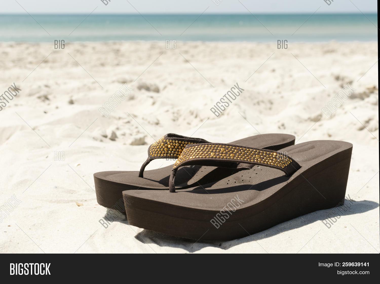 541da1a18 Flip Flops Sand On Sea Image   Photo (Free Trial)